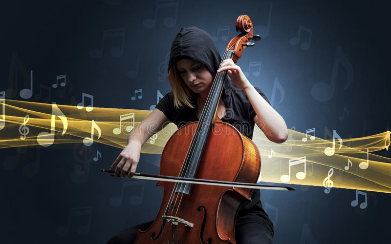 Musician playing on cello with notes around stock photos