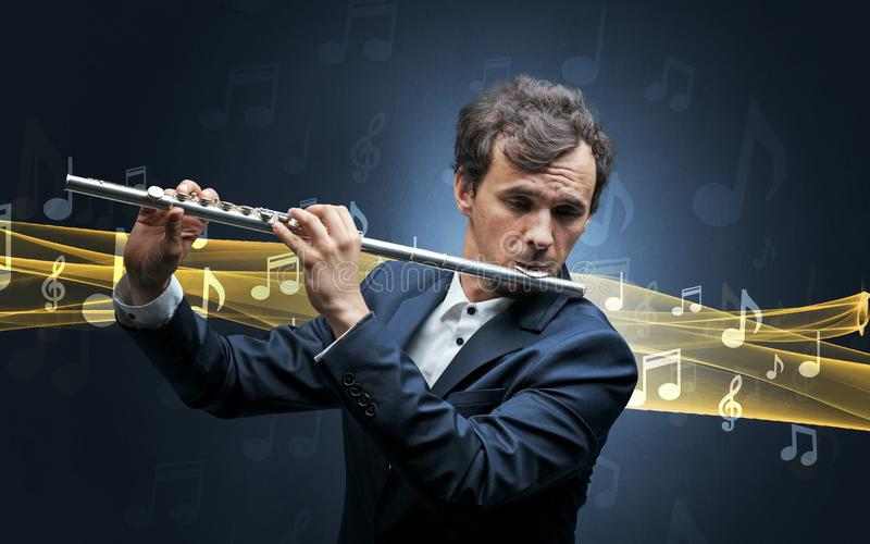 Musician playing on flute with notes around stock images