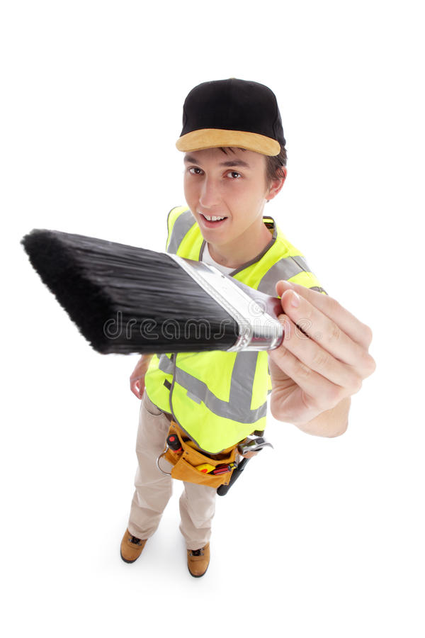 Young male with paintbrush. Young male apprentice holding a paintbrush ready for your message. White background stock photo