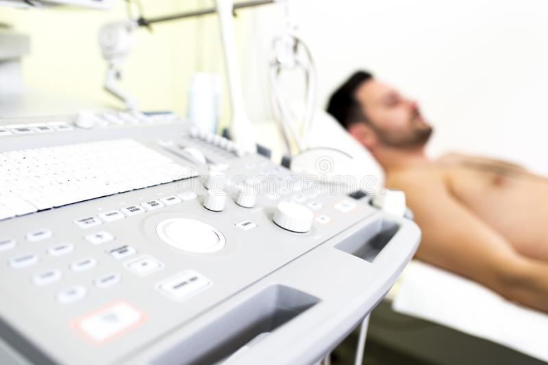 Young male patient in the ultrasound examination. At hospital royalty free stock images