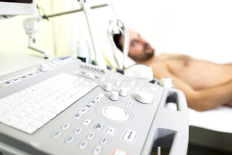 Young male patient in the ultrasound examination. At hospital stock photos
