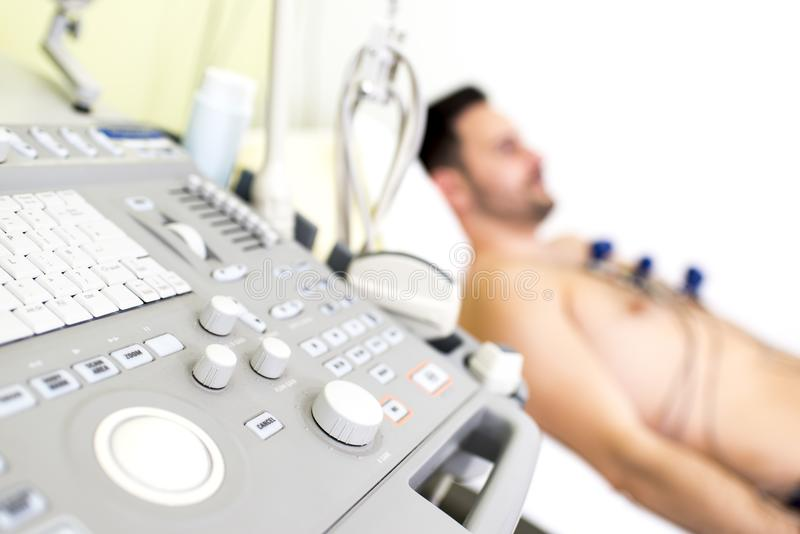 Young male patient in the ultrasound examination. At hospital stock images