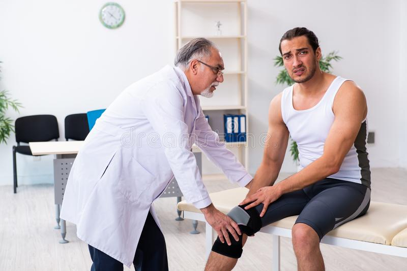 Young male patient visiting experienced doctor. The young male patient visiting experienced doctor royalty free stock images