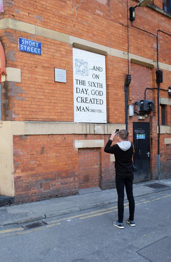 Young Male Photographing famous Mosaic in Manchester royalty free stock image