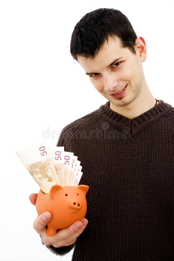 Young Male With Piggy Bank Royalty Free Stock Image