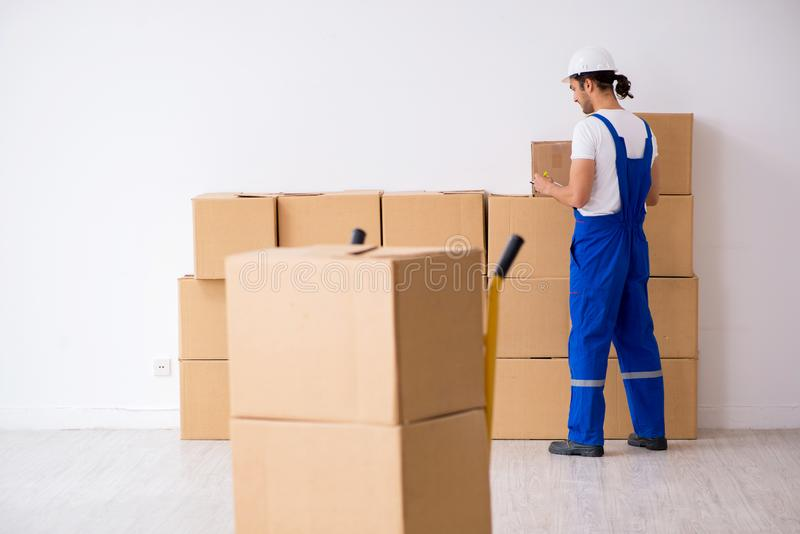 Young male professional mover doing home relocation. The young male professional mover doing home relocation royalty free stock photos
