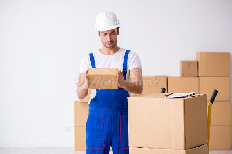 Young male professional mover doing home relocation. The young male professional mover doing home relocation stock image