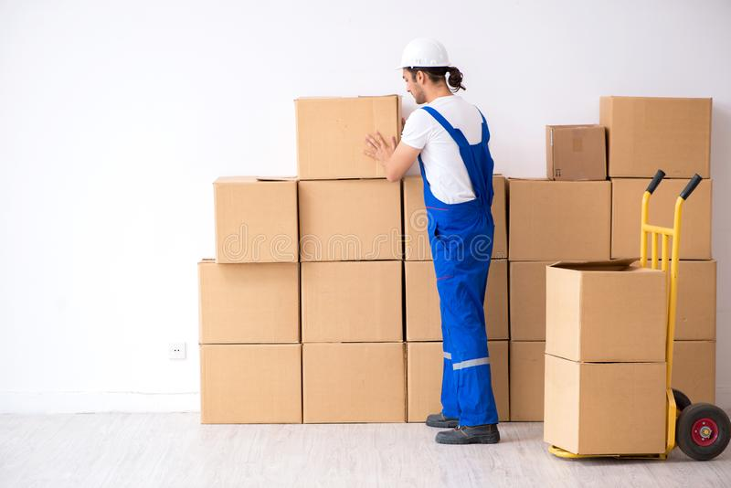 Young male professional mover doing home relocation. The young male professional mover doing home relocation stock images
