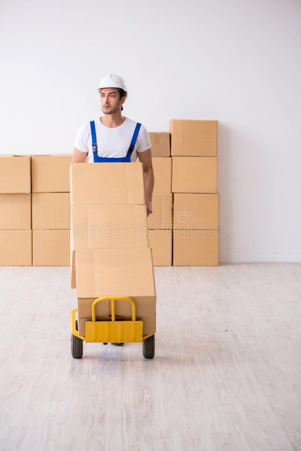Young male professional mover doing home relocation. The young male professional mover doing home relocation royalty free stock images
