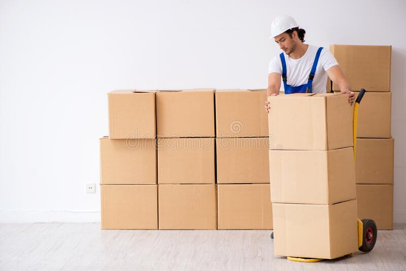 Young male professional mover doing home relocation stock photos