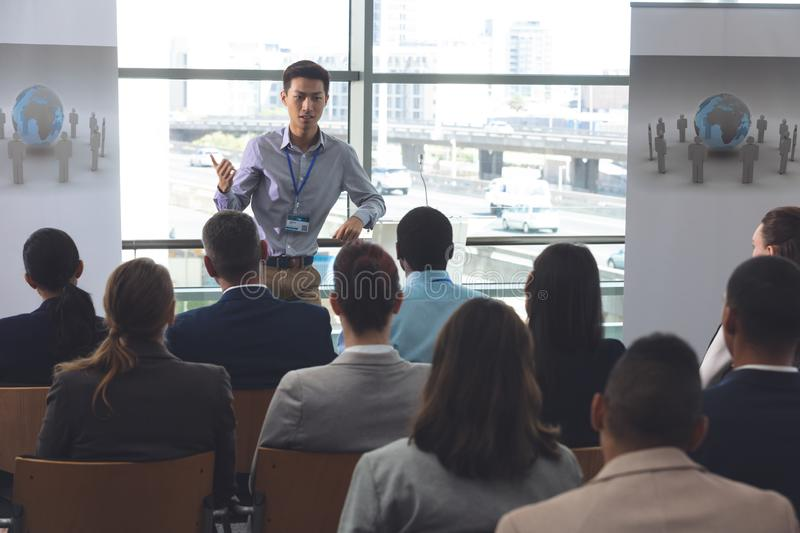 Young male professionals speaks at a business seminar stock photos