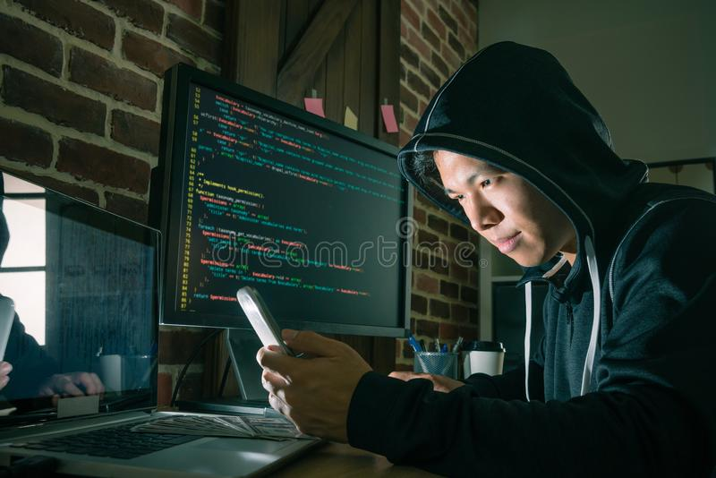 Young male programmer using mobile cell phone royalty free stock image