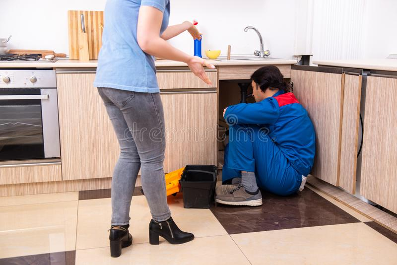 Young male repairman repairing tap. The young male repairman repairing tap stock photography