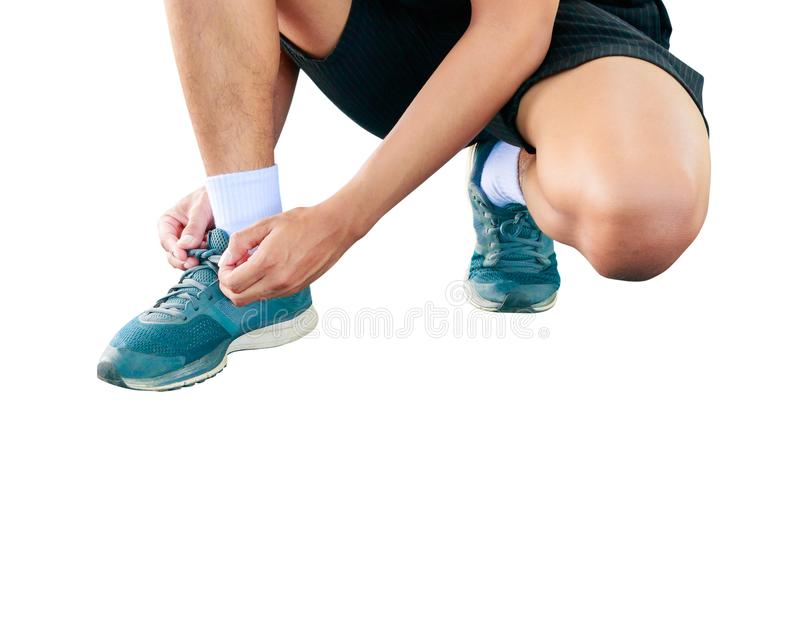 Young male runner tying shoelaces old in runner exercise for health lose weight concept isolated on white background.  stock photos