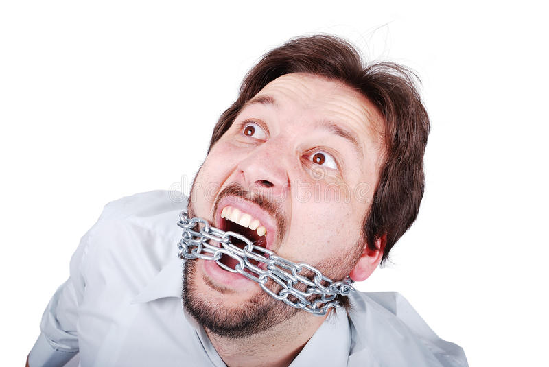 Young male is screaming with chain in mouth. Can not speak stock photography