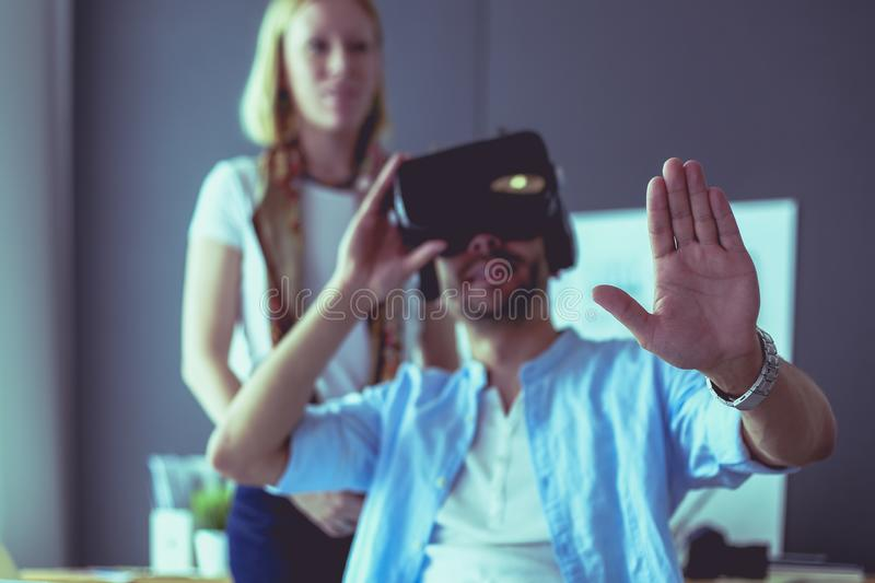 Young male software programmer testing a new app with 3d virtual reality glasses in office. royalty free stock photo