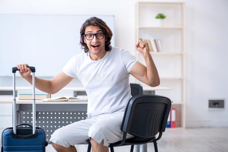 Young male student in front of whiteboard royalty free stock photo