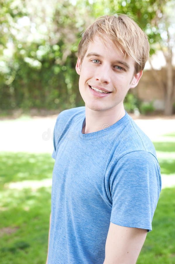 Young male student in a park stock photo