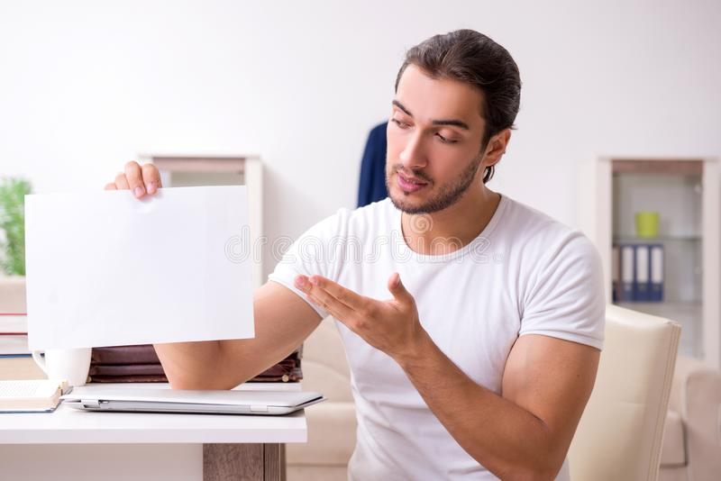 Young male student preparing for exams at home. The young male student preparing for exams at home stock photography