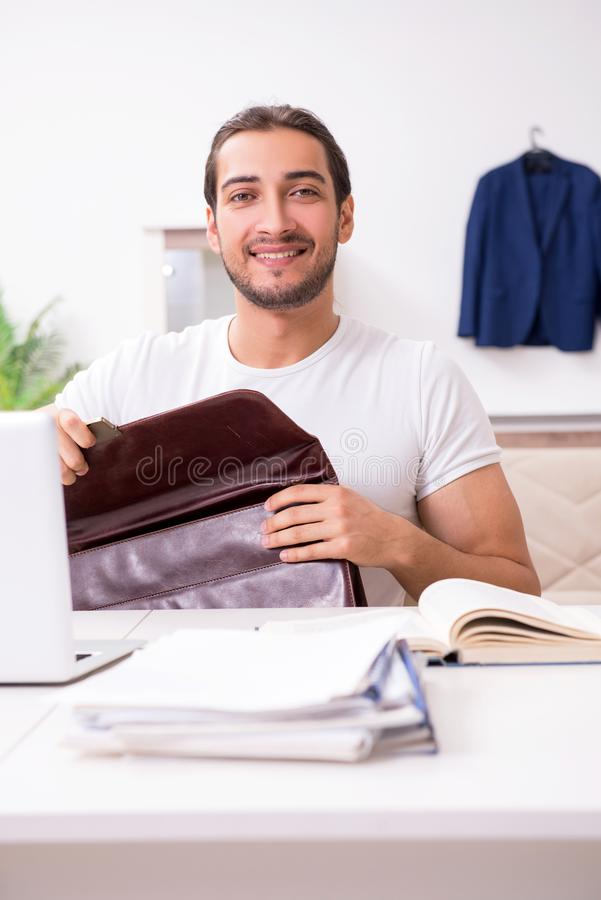 Young male student preparing for exams at home. The young male student preparing for exams at home royalty free stock images