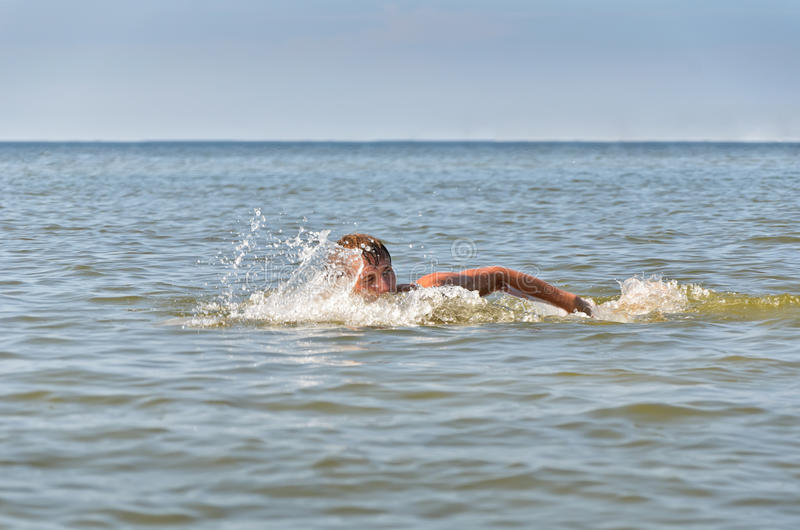 Download Young male swimming stock image. Image of blue, effort - 25993721