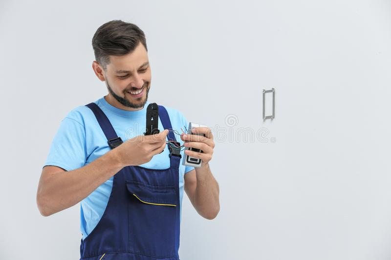 Young male technician fixing alarm system royalty free stock images