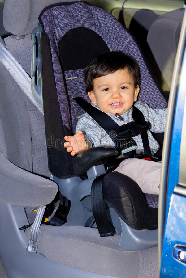 Young Male Toddler In Car Seat stock photo