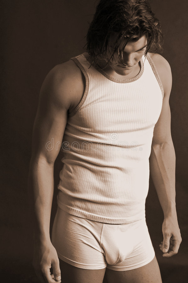 Young male in underwear sepia royalty free stock photography
