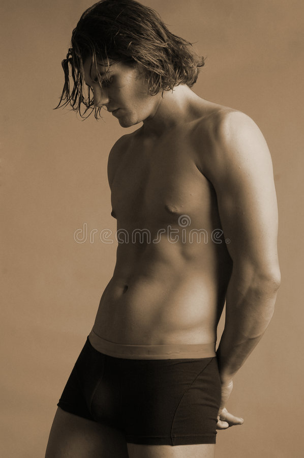 Young male in underwear sepia stock photos