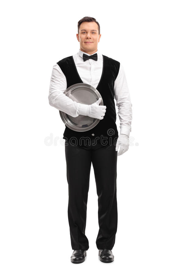 Young male waiter holding a tray royalty free stock images