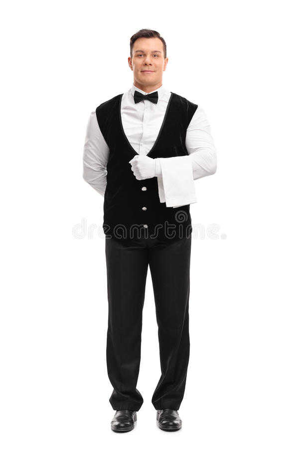 Young male waiter holding a white towel stock photography