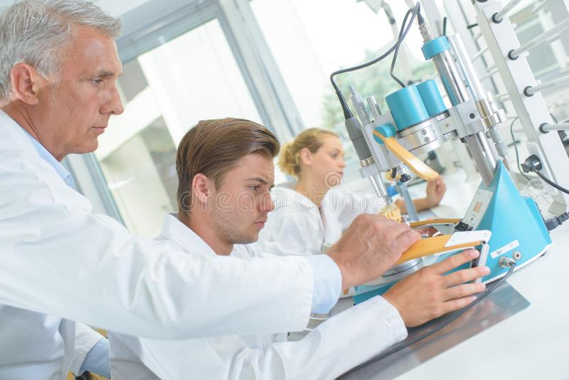 Young male worker at dental laboratory stock images