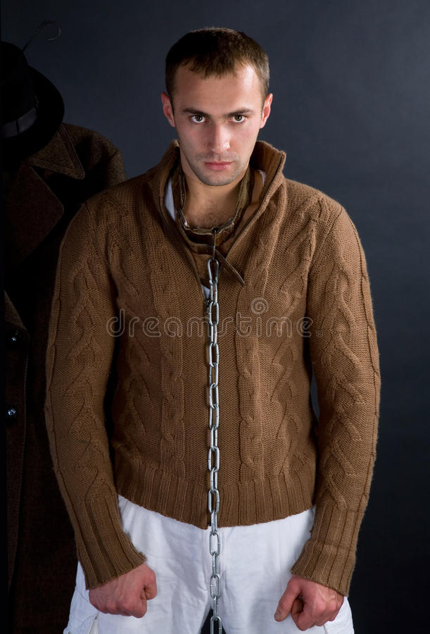 A young man. In a brown jacket that says something stock images