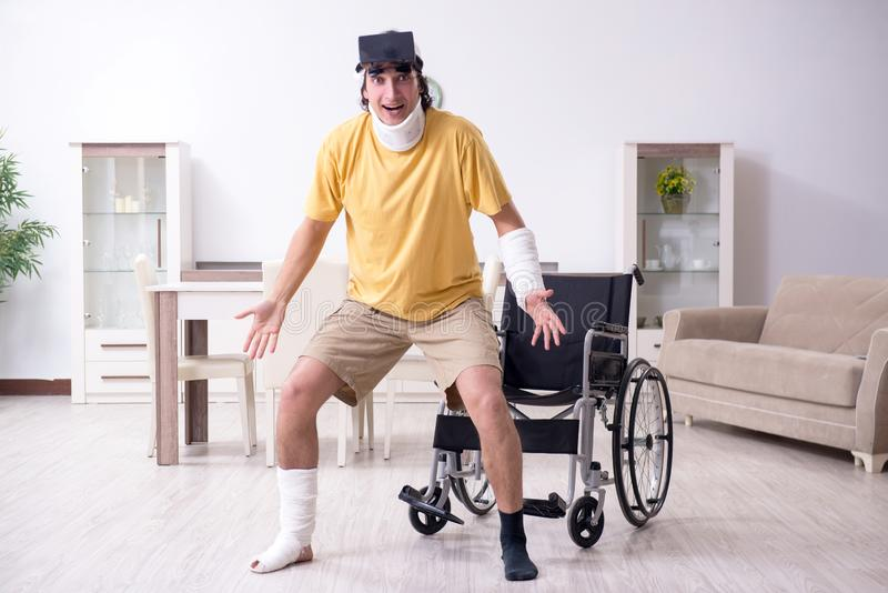 Young man after accident recovering at home. The young man after accident recovering at home stock image