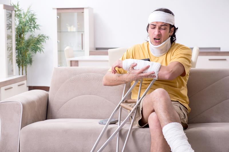Young man after accident recovering at home. The young man after accident recovering at home stock photo