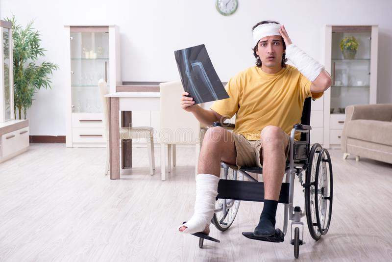 Young man after accident recovering at home. The young man after accident recovering at home royalty free stock photo