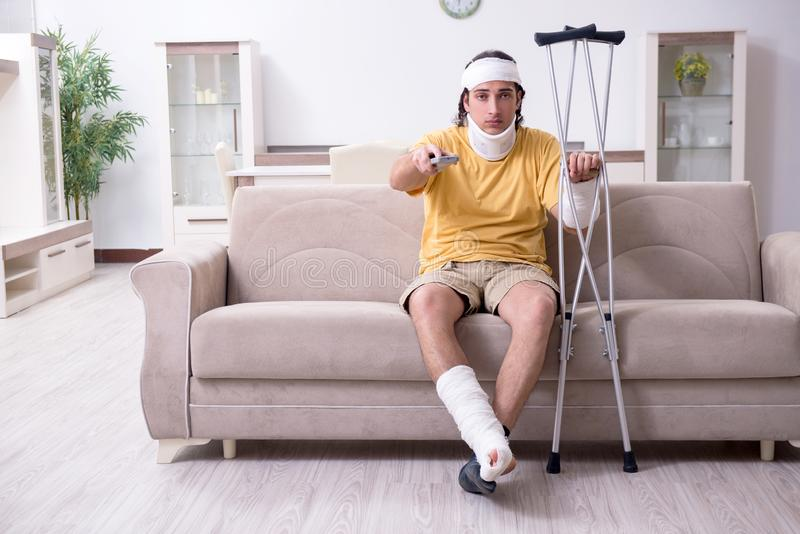 Young man after accident recovering at home. The young man after accident recovering at home royalty free stock photography