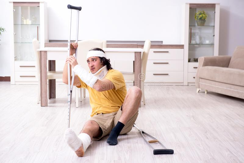 Young man after accident recovering at home. The young man after accident recovering at home royalty free stock photos