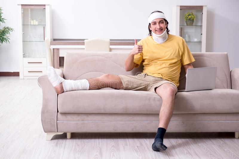 Young man after accident recovering at home. The young man after accident recovering at home royalty free stock image