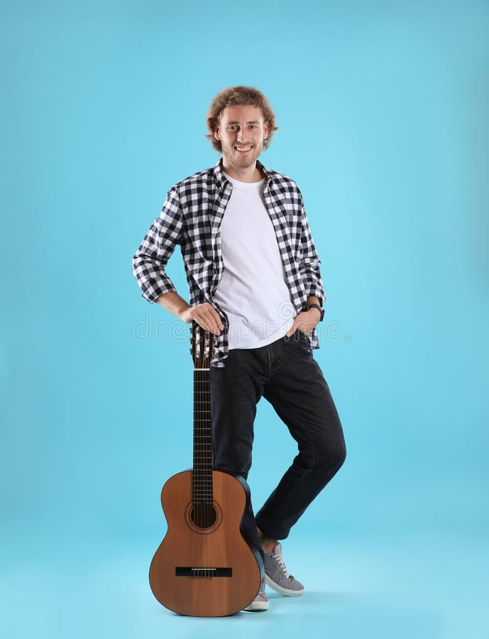 Young man with acoustic guitar royalty free stock photography