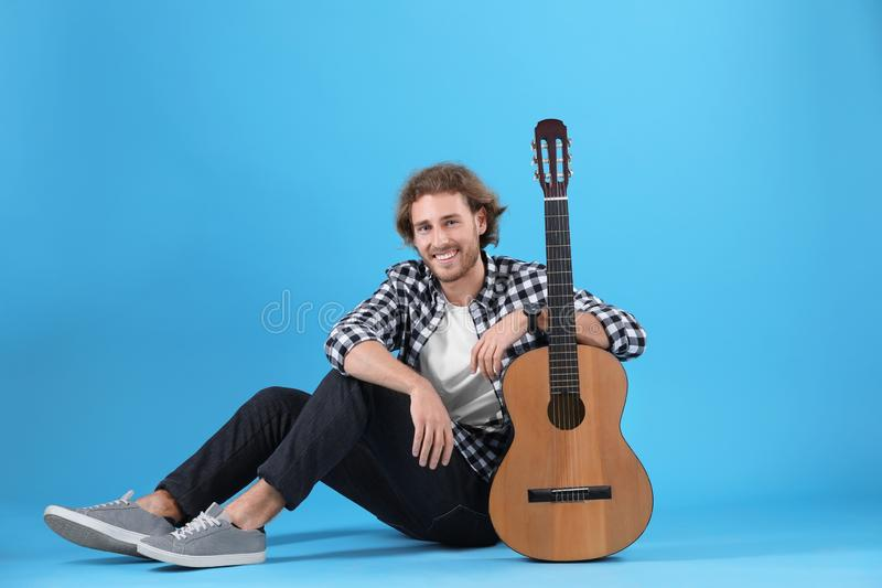 Young man with acoustic guitar royalty free stock photos