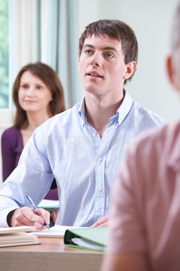 Young Man In Adult Education Class royalty free stock photos