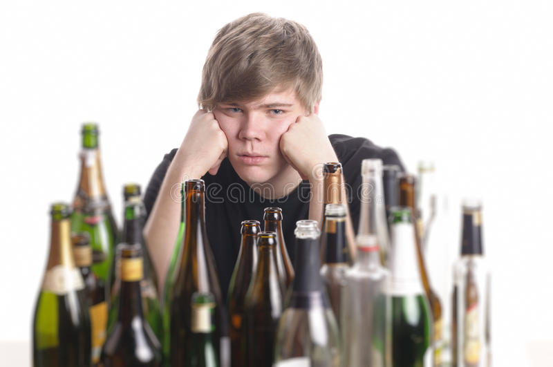 Young man alcohol abuse royalty free stock photography