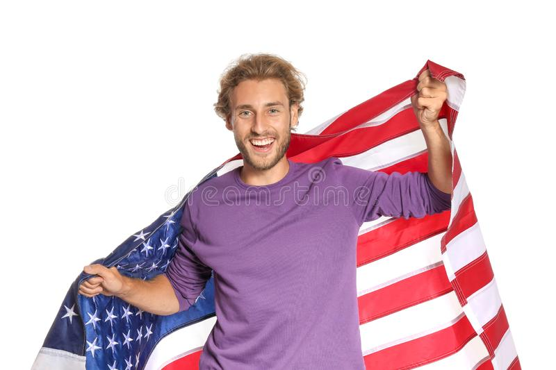 Young man with American flag. On white background stock image