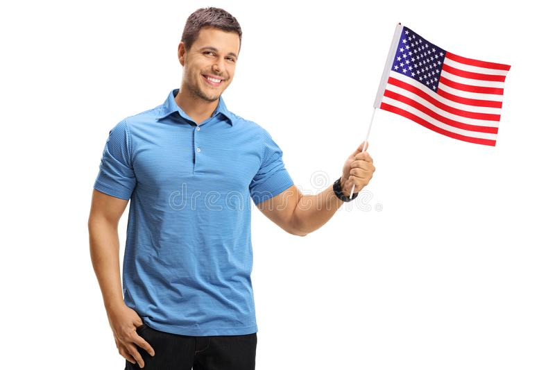 Young man with an American flag. Isolated on white background royalty free stock images