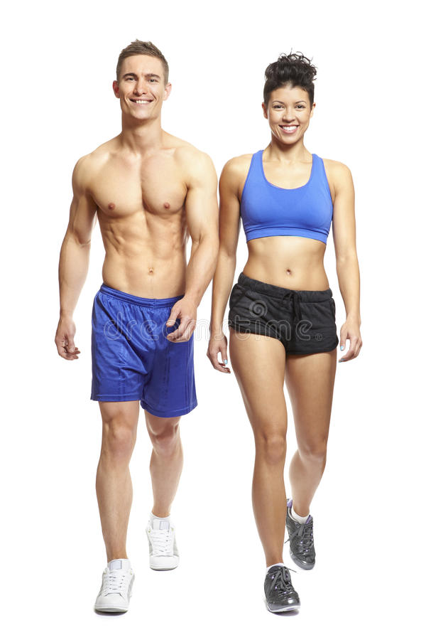 Free Young Man And Woman Walking In Sports Outfits Royalty Free Stock Photography - 28590157