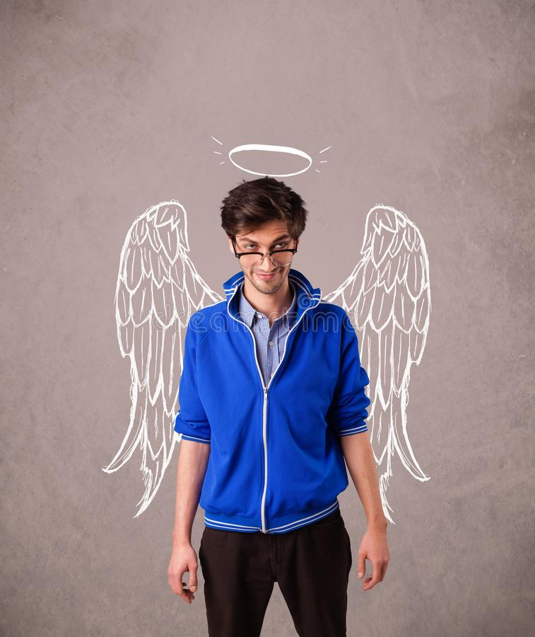 Young man with angel illustrated wings stock images