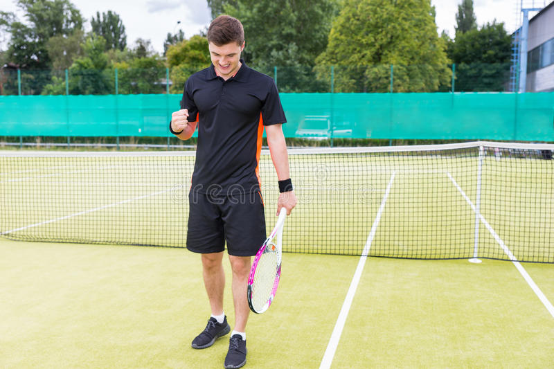 Young man angry because of the loss in tennis match and made a f royalty free stock images