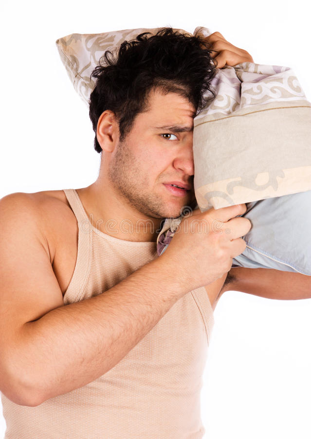 Young man annoyed by the noise royalty free stock photos