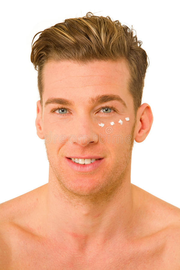 Young Man With Anti-wrinkle Cream Royalty Free Stock Images